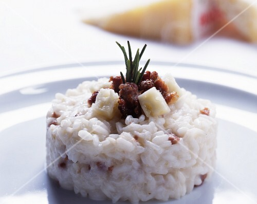 Risotto al panerone (cheese risotto with sasiccia and cubes of cheese)