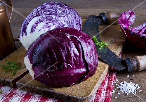 A red cabbage and a curved chopping knife