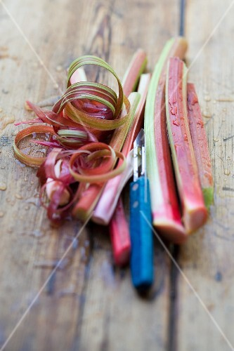 Rhubarb stalks with peel and a peeler