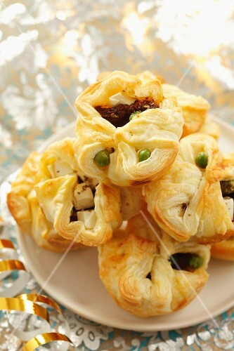 Puff pastries filled with peas, dried tomatoes and feta cheese