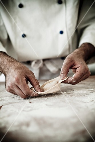 A chef making a tortellino