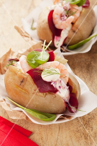 Baked potatoes with beetroot and prawns