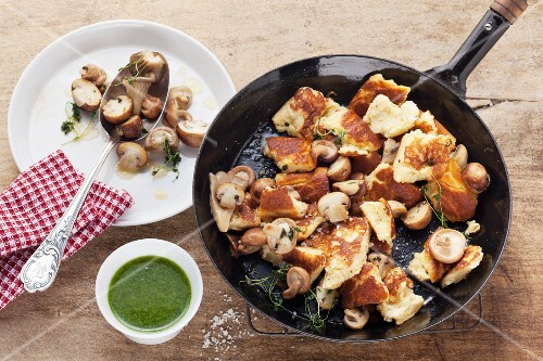 Chopped-up potato pancake with mushrooms