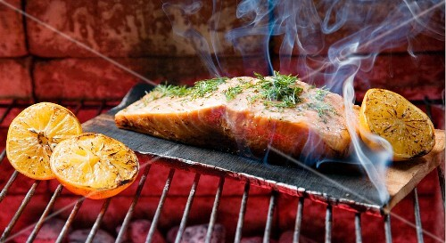 Salmon Topped with Lemon and Dill on an Applewood Plank; On the Grill