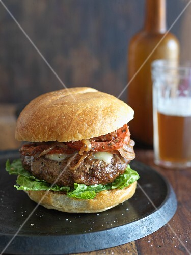 Cheeseburger with Grilled Onions and Tomato
