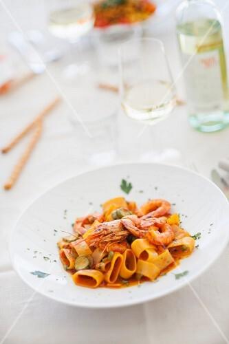 Pasta calamarata (pasta with prawns, tomato sauce and courgette)