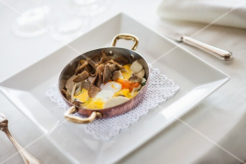 Uova alla piemontese (eggs with melted cheese, mushrooms and truffle slices)