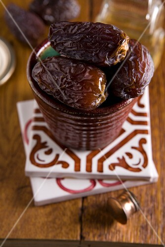 Dried dates in a ceramic pot