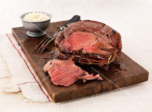 Roast beef, sliced, on a chopping board