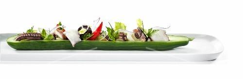 Octopus salad arranged in half a cucumber