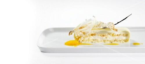 Tiramisu with orange sauce and white chocolate