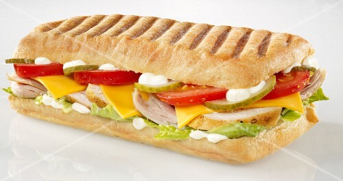Chicken, tomato, gherkin, cheese slice and lettuce panini