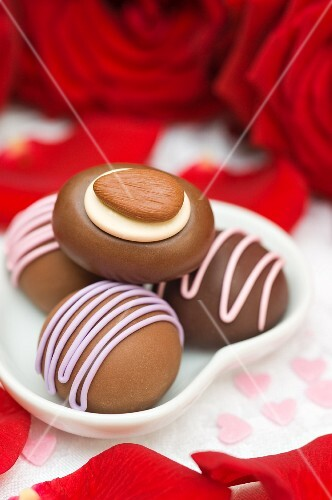 Chocolates in a heart-shaped dish for Valentine's Day