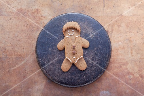 Decorated Gingerbread Man Cookie with a Glass of Milk