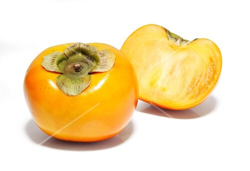 Whole and sliced sharon fruit