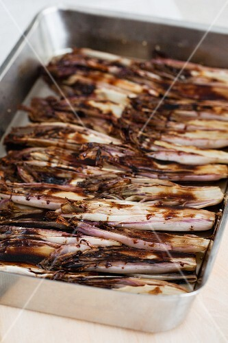 Marinated roasted endives in a roasting tin