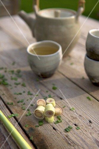 Lemongrass tea, tea paraphernalia and fresh lemongrass