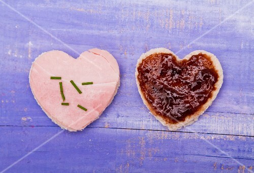 Two hearts cut out of bread, one with ham and one with jam, for Valentine's Day