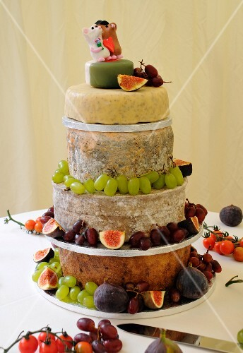 A wedding cake of cheese with fruit