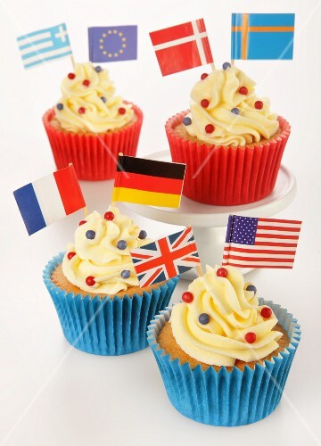 Cupcakes decorated with buttercream and various flags