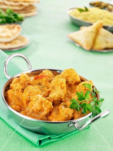 Chicken korma with samosas and naan bread (India)