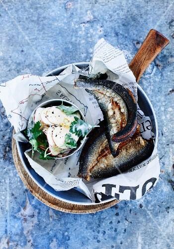 Fried herrings with potato salad