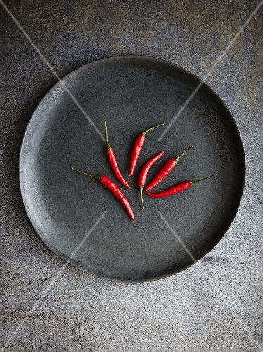 Red chilli peppers on a plate
