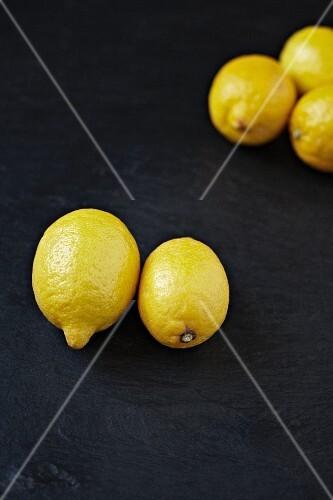 Several lemons on a slate