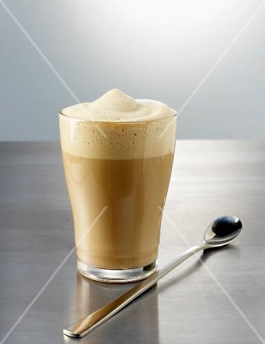 Stirred latte macchiato with spoon