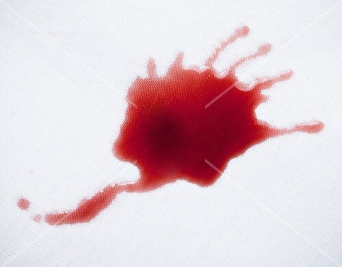 A red wine spillage on a table cloth