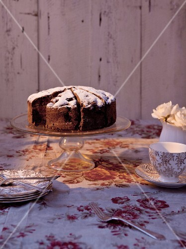 Chocolate cake dusted with icing sugar and sliced