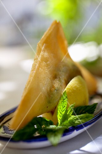Deep-fried filo pastry parcel with tuna filling (Tunisia)