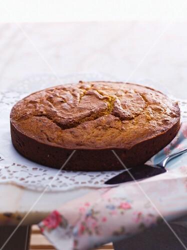 A whole almond cake on a doily