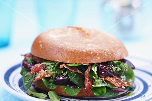Beetroot burger with strips of crispy bacon