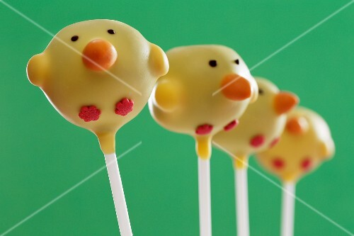 Four cake pops (chicks) in a line