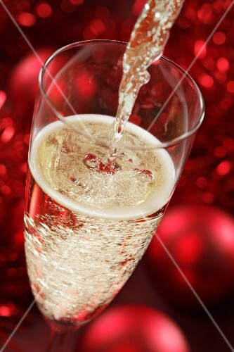 Sparkling wine being poured (Christmassy)