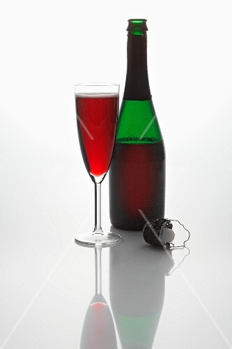 Red sparkling wine (in a bottle and in a glass, and a cork)