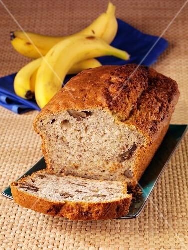 Banana and walnut bread with a slice already cut