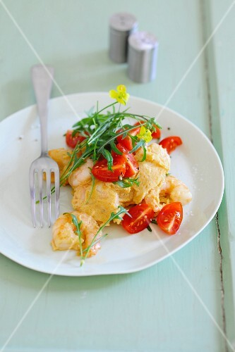 Prawns in egg, tossed with fresh tomatoes and rocket