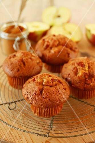 Apple and cinnamon muffins on a cooling rack