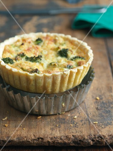 Individual Broccoli and Cheese Quiche On Top of Baking Tin