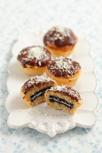 Coconut muffins filled with chocolate biscuits