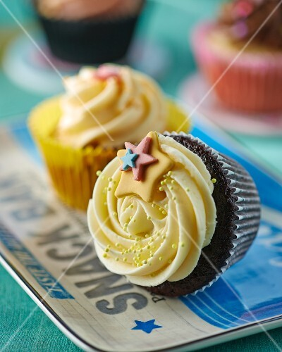 A cupcake decorated with stars, lying on its side