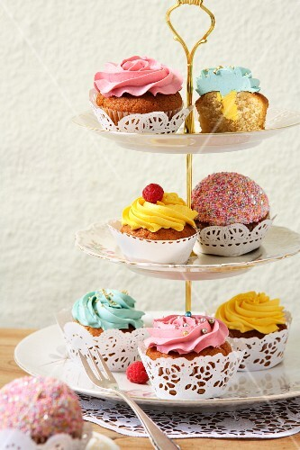 Various cupcakes on a cake stand