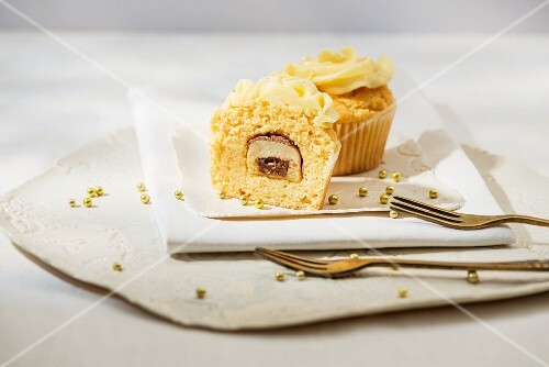 A cupcake with a marzipan praline in the middle