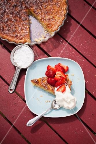Mazarin cake (almond cake, Sweden) with strawberries and cream