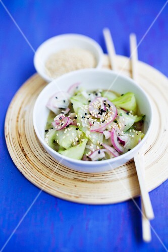 Cucumber salad with red onions and sesame seeds