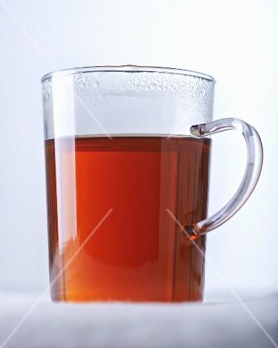 Hot tea in a glass mug
