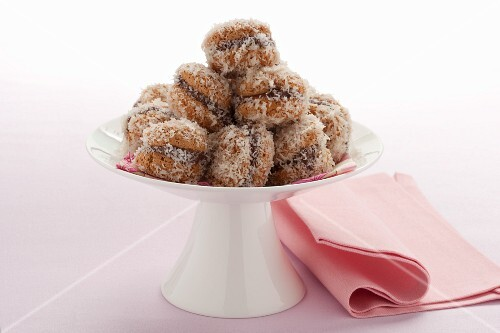 Bombe al cocco (chocolate macaroons rolled in coconut)