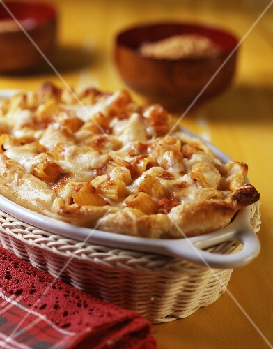 Pasta bake with sausage, béchamel and tomato sauce in puff pastry